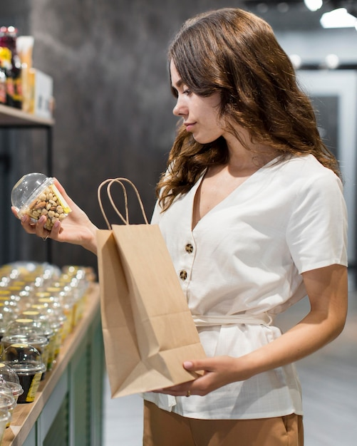 Portrait of woman shopping organic products Free Photo