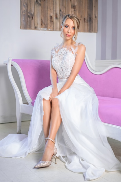 Portrait of a woman with a beautiful wedding make-up and hair on the couch Premium Photo