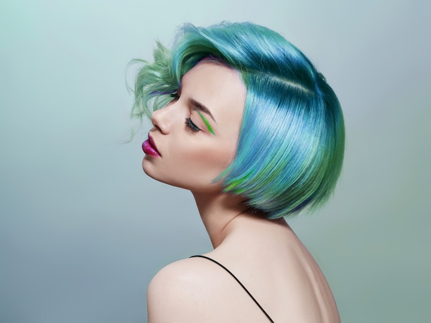 Portrait of a woman with bright colored flying hair Premium Photo