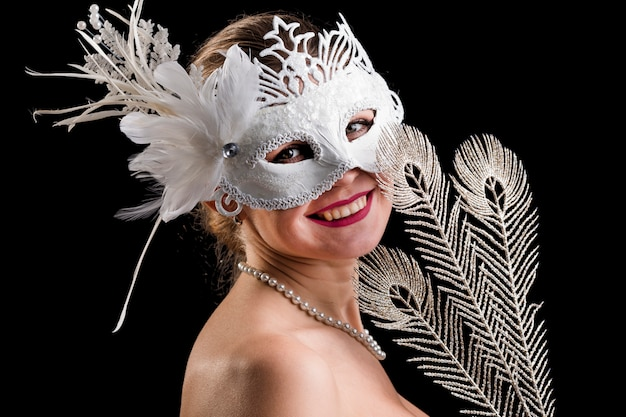 Portrait of woman with carnival mask Free Photo