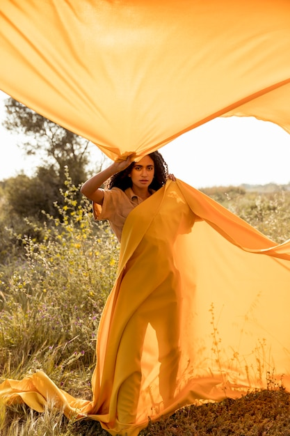 Portrait of woman with cloth in the fields Free Photo