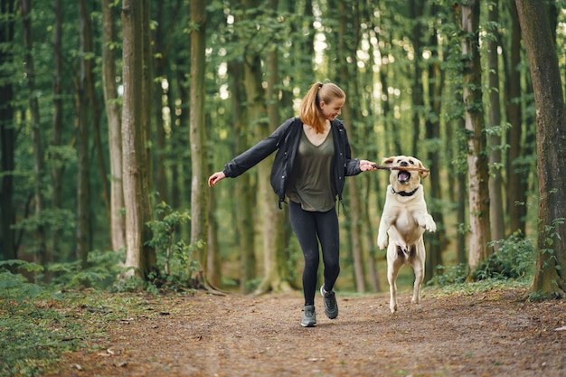 Portrait of a woman with her beautiful dog Free Photo