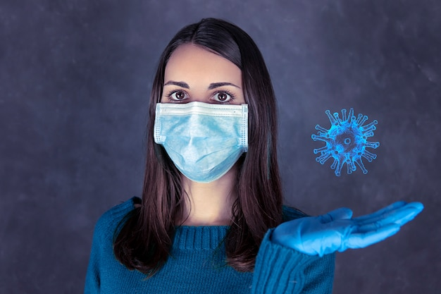 Premium Photo | Portrait of a woman with mask and gloves holding coronavirus