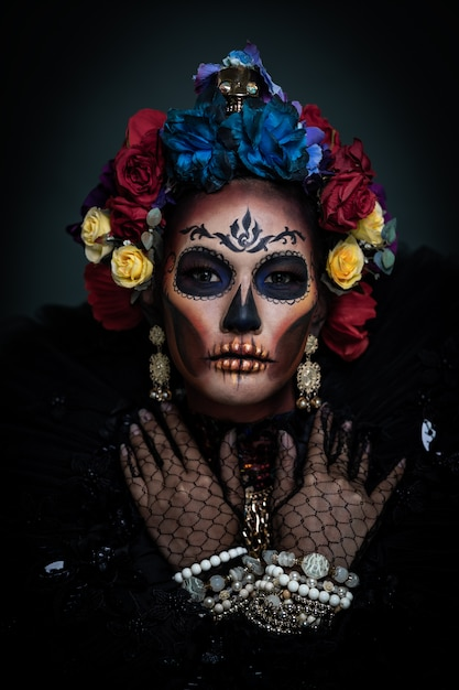 Premium Photo Portrait Of A Woman With A Sugar Skull Makeup Dressed With Flower Crown