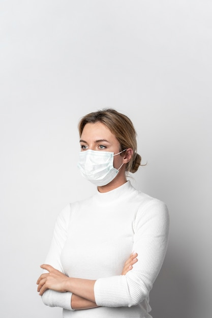 Portrait of woman with surgical mask posing Free Photo
