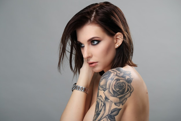 Portrait of woman with tattoo Free Photo
