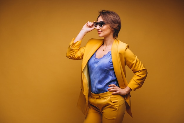 Portrait of woman in yellow suit isolated Free Photo