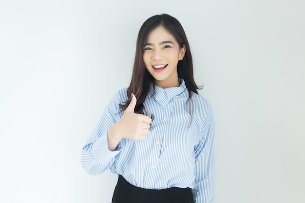 Portrait of young asian business woman thumbs up very good symbol on white background. Premium Photo