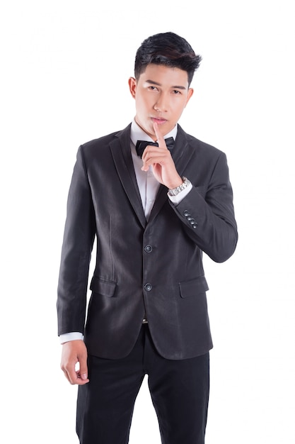 Portrait of young asian confident man dressed in tuxedo with bow tie isolated on white background Premium Photo