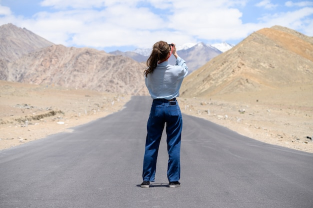 Portrait of young asian woman taking photos on the road Premium Photo