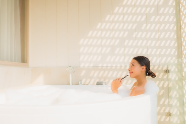 Free Photo Portrait Young Asian Woman Using Smart Mobile Phone In Bathtub