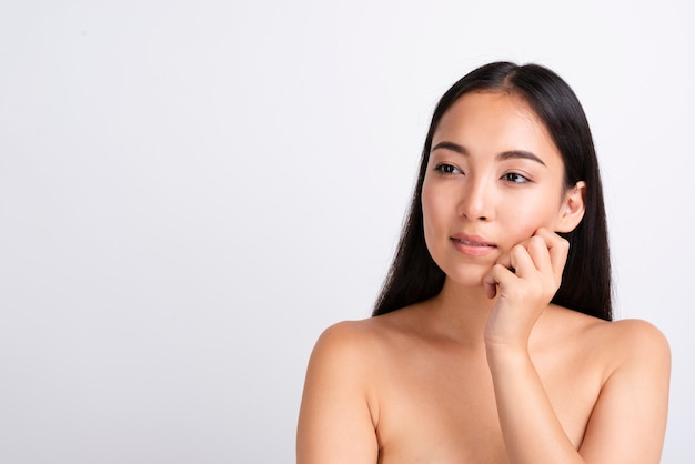 Portrait of  young asian woman with clear skin Free Photo