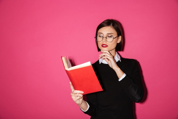Portrait of a young attractive businesswoman  reading a book Free Photo