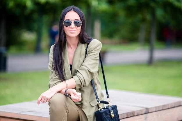 Portrait of young attractive tourist woman outdoors Premium Photo