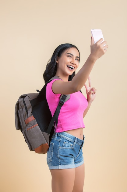 Portrait of a young attractive woman making selfie photo with the smartphone Free Photo