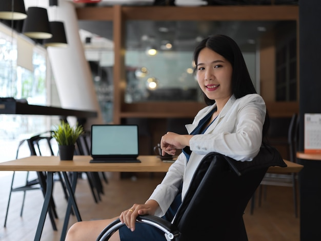 Premium Photo   Portrait of young beautiful asian businesswoman looking to  the camera confidently in her office room