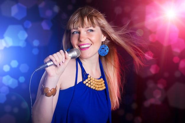 Portrait of young beautiful girl singing Premium Photo