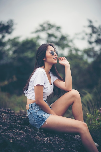 Portrait Of Young Beautiful Girl Woman Happy With Nature Against Background Of Mountain Premium Photo