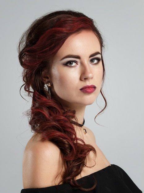 Portrait of a young beautiful red haired caucasian woman Premium Photo