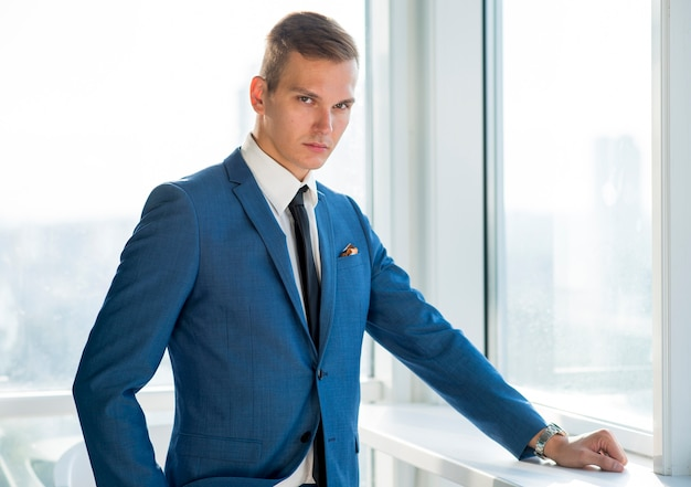 e88d60e1b0d2 Portrait of a young businessman looking at camera Photo | Free Download