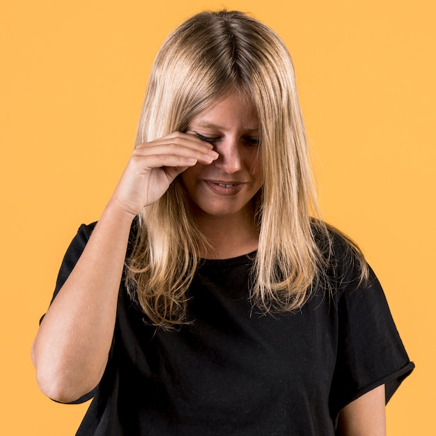 Portrait of young disable woman crying on plain backdrop Free Photo