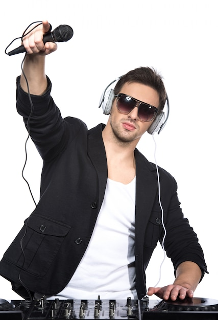Portrait of a young dj standing at the mixer. Premium Photo