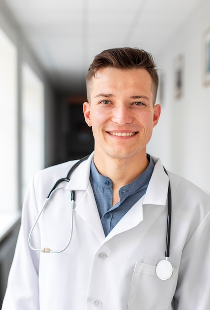 Portrait of young doctor in hospital Free Photo