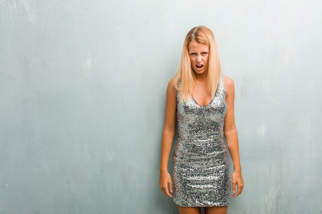 Portrait of young elegant blonde woman very angry and upset, very tense Premium Photo
