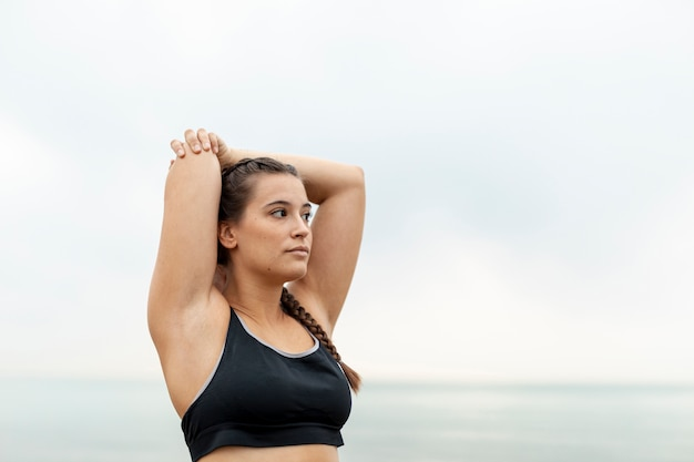 Portrait of young girl in sportswear exercising Free Photo