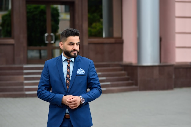 Portrait of a young handsome arab businessman looking away thoughtfully posing outdoors Premium Photo