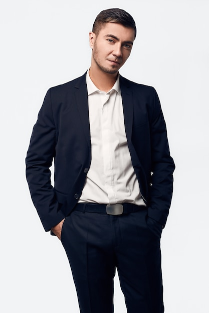 Portrait of young handsome business man in suit Premium Photo