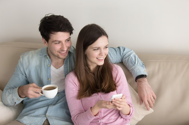 Portrait of young happy couple relaxing indoors Free Photo