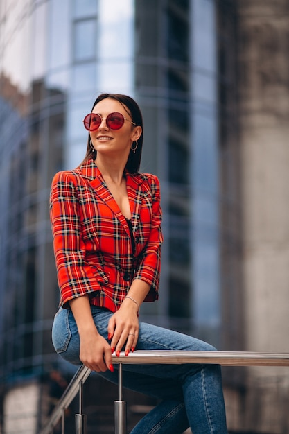 Portrait of a young lady in red jacket Free Photo