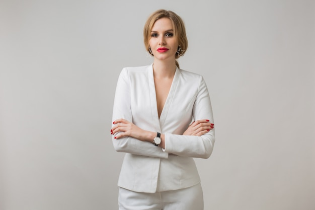 Portrait of young lady in white suit confident Free Photo