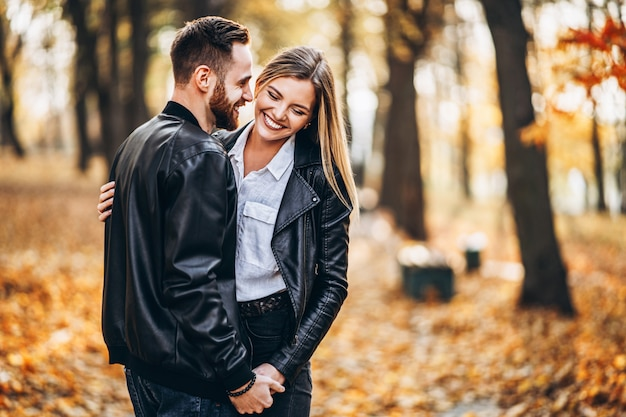 Portrait of a young loving couple hugging and smiling Premium Photo