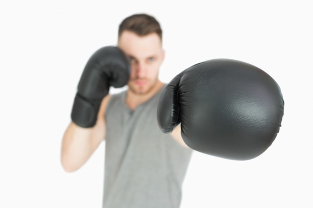 Portrait of young male boxer punching Premium Photo