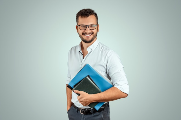 Portrait of a young male teacher on a light background Premium Photo