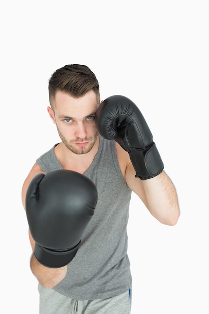 Portrait of young man in boxing stance Premium Photo