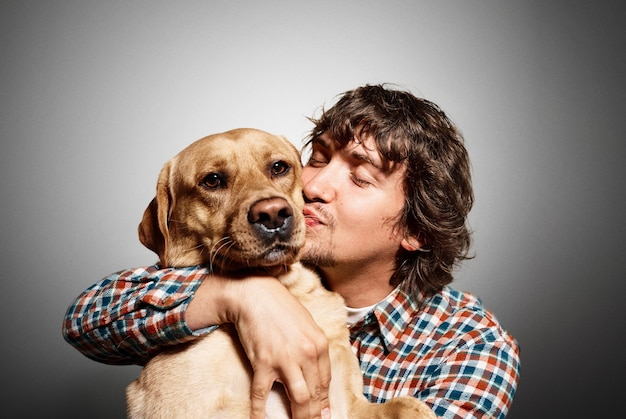 Portrait of young man and his cute dog Free Photo