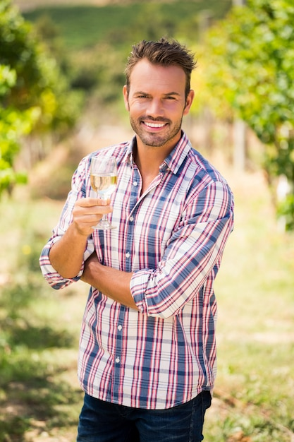 Portrait of young man holding wineglass Premium Photo