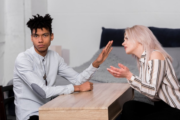 Portrait of a young man ignoring her girlfriend arguing with him Free Photo