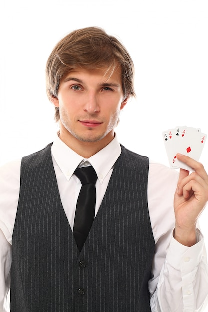 Portrait of young man showing poker cards Free Photo