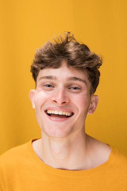 Portrait of young man  in a yellow scene Free Photo