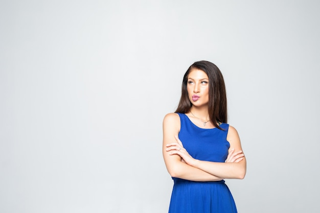 Portrait of young n woman standing with folded hands Free Photo