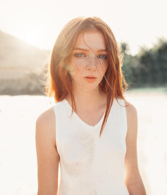 Portrait of the young pretty red-haired woman Premium Photo