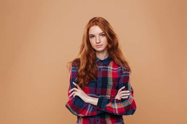 Portrait of a young pretty redhead girl Free Photo