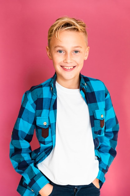 Portrait young and smiley boy dressed casual Free Photo