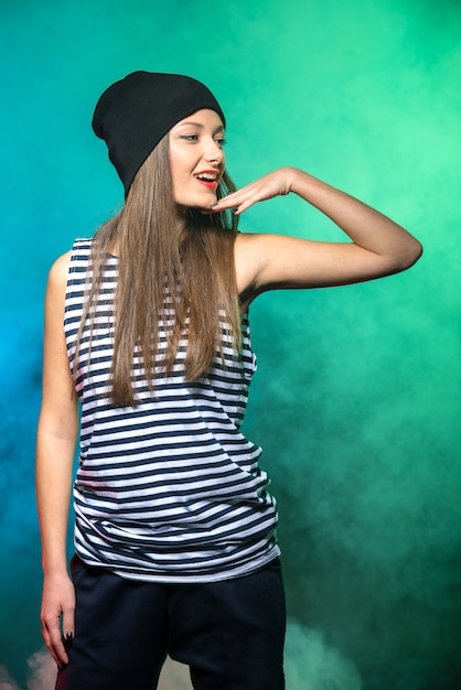 Portrait of a young smiling girl hip hop dancer. Premium Photo