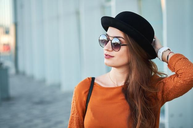 Portrait of young stylish girl Premium Photo