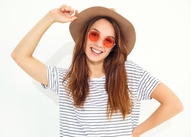 Portrait of young stylish laughing woman model in casual summer clothes in brown hat with natural makeup isolated on white wall Free Photo